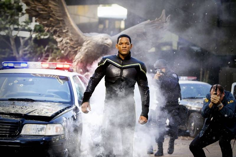 Hancock walks through police bullets toward the camera