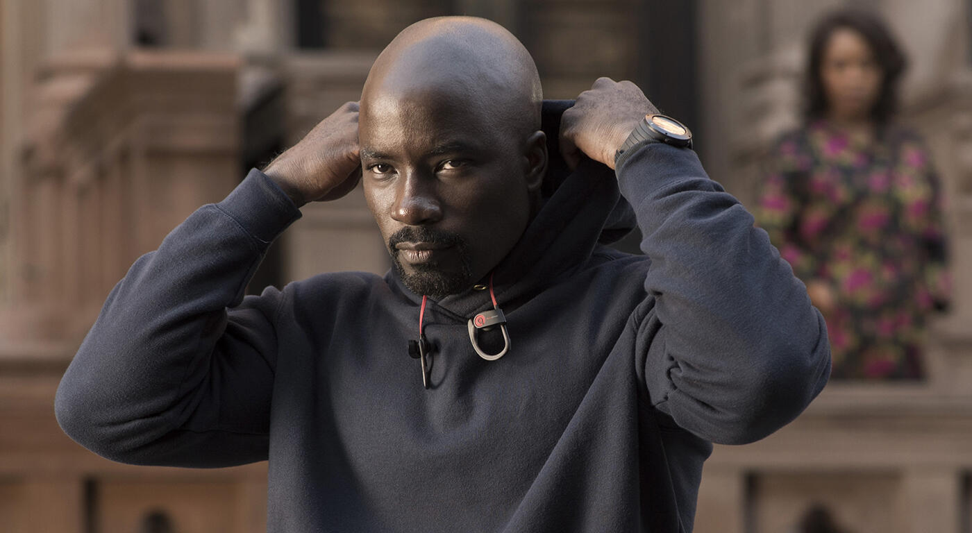 Luke Cage puts on his hood with a look of determination