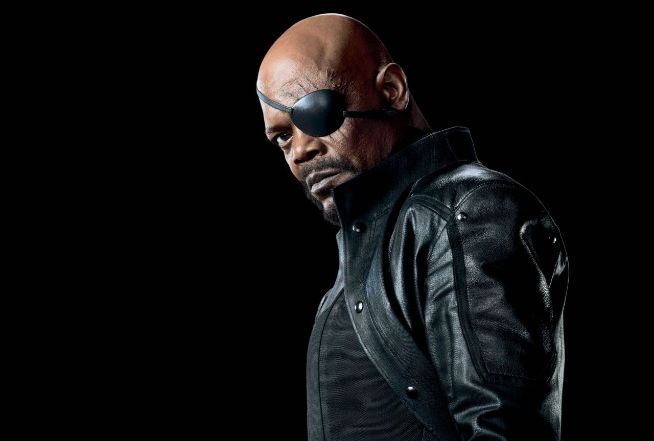 Nick Fury stares into the camera with one eye covered by a patch
